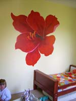 mural of a large flower on the wall